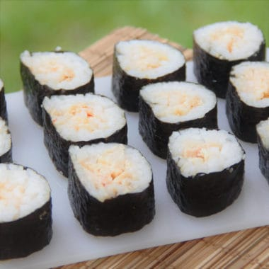 The roll of sushi is sliced just before serving in this outdoor friendly sushi recipe that uses canned tuna. #bushcooking #sushi #tuna #tunasushi