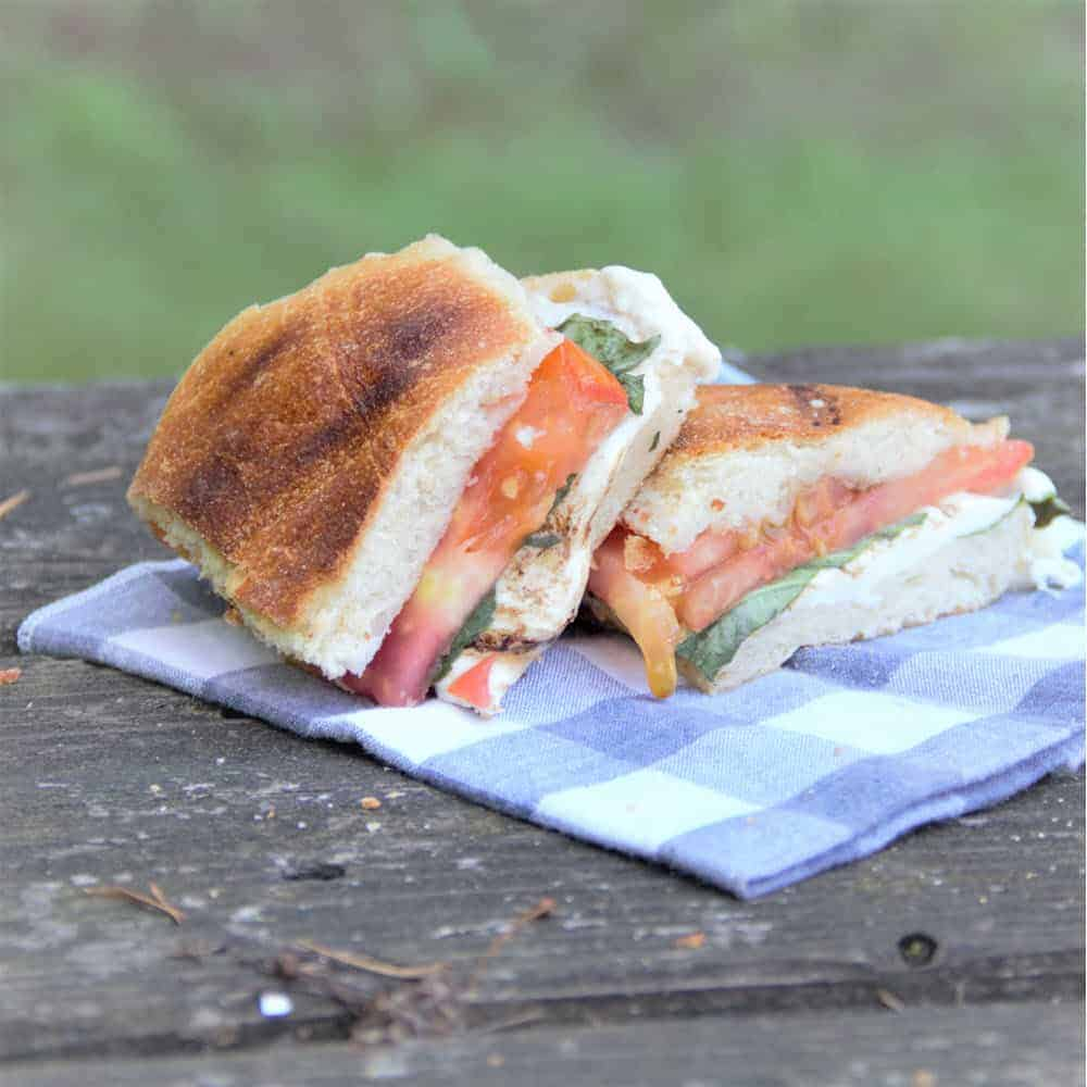 Caprese Panini is a wonderfully easy melt of tomato, basil and mozzarella cooked on the grill. #bushcooking #panini #sadwich