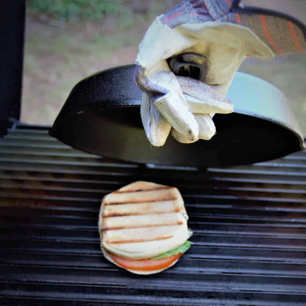 Caprese Panini cooked on a grill requires a little bit of technique but once you get it, cooking perfectly melted and toasted sandwiches is possible. #bushcooking #panini #sandwich #caprese