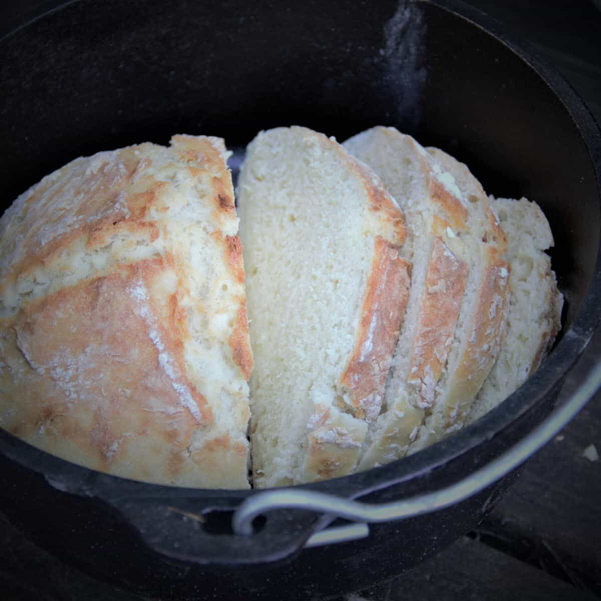 Soda Bread cooked in a Dutch oven is a great camping option for bread. Keep it in the Dutch oven to keep warm before serving. #bushcooking #sodabread #dutchovenbread