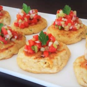This recipe is a scratch made corn cake that includes fresh corn kernels that is then topped with a cucumber and tomato pico de gallo. #bushcooking #corncakes #picodegallo