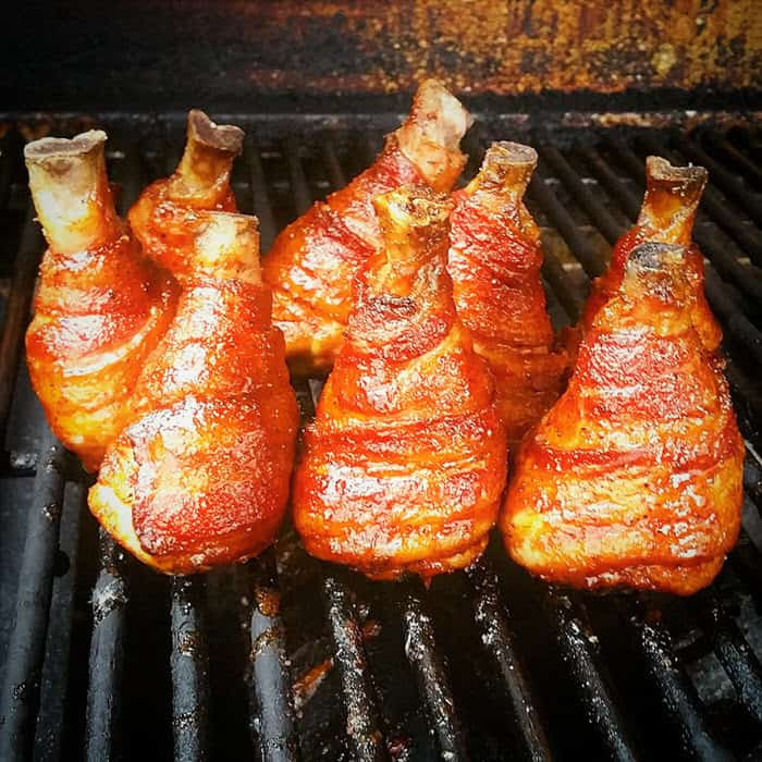Bacon Wrapped Chicken Legs undergoing their second cook after being glazed.