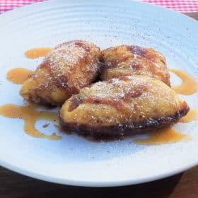 Apple dumplings served on a plate ready to eat.