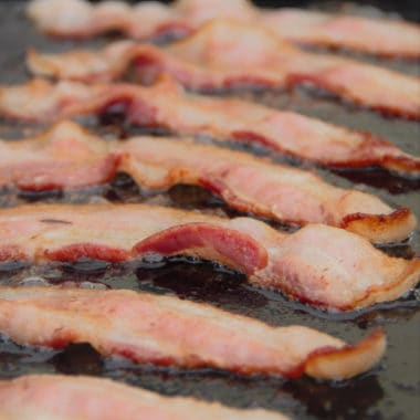 Bacon sizzling on a hotplate