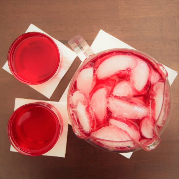 Areal photo of a drink pitcher and two glasses