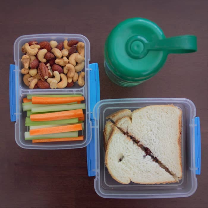 Areal photo of two lunch boxes and a drink.
