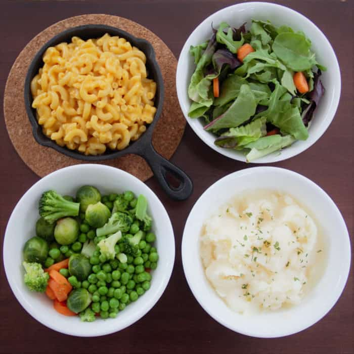 Areal view of 4 side dishes - mac and cheese salad, vegetables and mashed potato