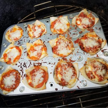 Cupcake tray with the lasagna cups in a barbecue.