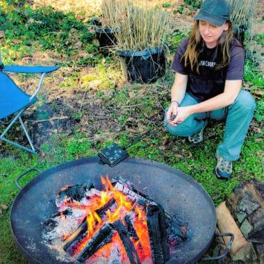 Saffon Hodgson Cooking in a pie Iron over a Campfire