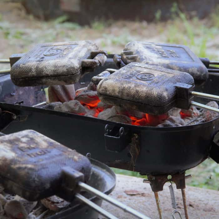 Multiple Cooking Irons over hot charcoals