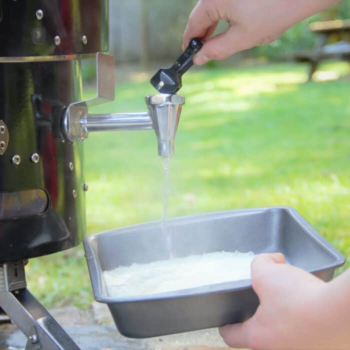 Water being added to a tray of dehydrated mashed potato.