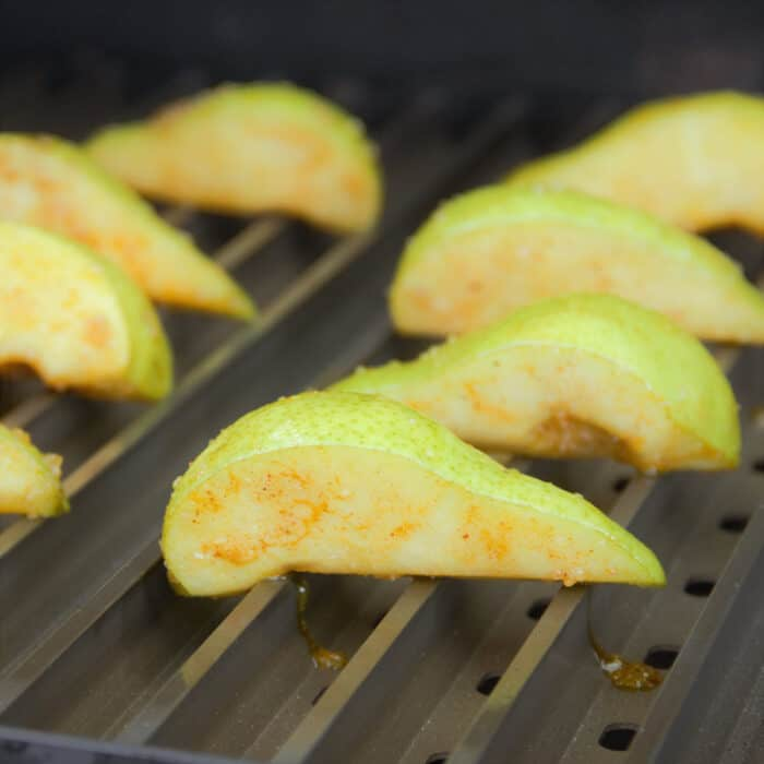 Fresh pear quarters just added to hot Grillgrates